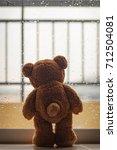lonely teddy bear in the rain | Shutterstock . vector #712504081