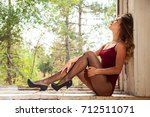 beautiful blonde in red bodysuit | Shutterstock . vector #712511071