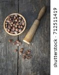 background of hazelnuts and... | Shutterstock . vector #712511419
