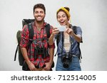 positive male and female... | Shutterstock . vector #712514005