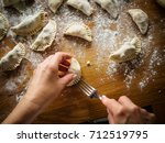 making dumplings  | Shutterstock . vector #712519795