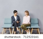 lively conversation in queue.... | Shutterstock . vector #712523161