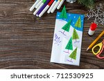 the child makes a greeting card ... | Shutterstock . vector #712530925