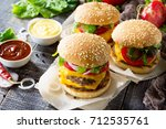 a double burger with a meat... | Shutterstock . vector #712535761