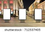 three blank street billboards... | Shutterstock . vector #712537405