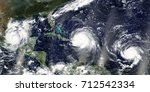 overview of three hurricanes... | Shutterstock . vector #712542334