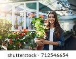 young florist or gardener... | Shutterstock . vector #712546654