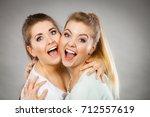 two happy friends women hugging ...   Shutterstock . vector #712557619