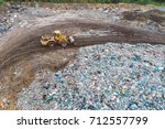 aerial view of landfill. waste  ... | Shutterstock . vector #712557799