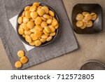tasty lupins in metal mug and... | Shutterstock . vector #712572805