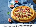 pumpkin ricotta basil figs tart.... | Shutterstock . vector #712573735