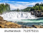 Small photo of Laksforsen is a waterfall of 17 meters. The river is called Vefsna and the average amount of water going through the waterfall is 700 m3/sec. Norway.