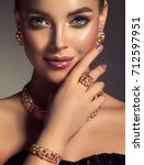 beautiful girl with jewelry . a ...   Shutterstock . vector #712597951