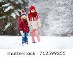 two adorable little girls... | Shutterstock . vector #712599355
