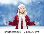 adorable little girl having fun ... | Shutterstock . vector #712600495