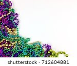 colorful beads on a white... | Shutterstock . vector #712604881