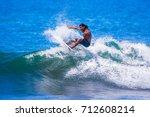 riding the waves. alberto munoz ... | Shutterstock . vector #712608214