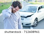 man feeling pain to the neck... | Shutterstock . vector #712608961