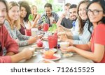 group of happy friends toasting ... | Shutterstock . vector #712615525