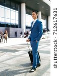 businessman pulling a trolley... | Shutterstock . vector #712617631