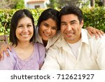 hispanic family with a teen... | Shutterstock . vector #712621927