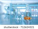 orange fluid movement in water... | Shutterstock . vector #712624321