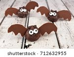 halloween chocolate donut hole... | Shutterstock . vector #712632955