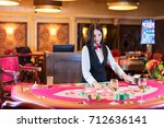 cute lady casino dealer at... | Shutterstock . vector #712636141