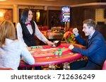 cute lady casino dealer at... | Shutterstock . vector #712636249