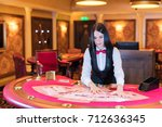 cute lady casino dealer at... | Shutterstock . vector #712636345