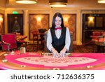 cute lady casino dealer at... | Shutterstock . vector #712636375