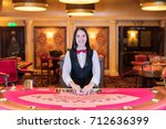 cute lady casino dealer at... | Shutterstock . vector #712636399