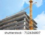 crane and building under... | Shutterstock . vector #712636807