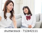 asian parent and daughter who... | Shutterstock . vector #712642111
