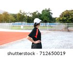 young female stretching before... | Shutterstock . vector #712650019