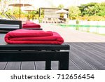 Red Towel On Bed Beach At...