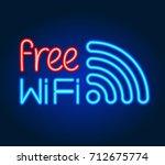 free wifi   neon sign. wireless ... | Shutterstock .eps vector #712675774