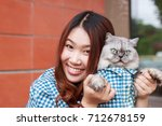 close up of young asian woman... | Shutterstock . vector #712678159