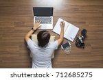 top view of women lying working ...   Shutterstock . vector #712685275