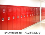 close up on red lockers in gym | Shutterstock . vector #712692379