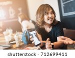 asian woman holding the... | Shutterstock . vector #712699411