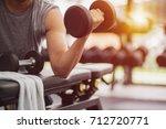 muscular man detail lifting... | Shutterstock . vector #712720771