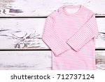 baby girl new organic romper.... | Shutterstock . vector #712737124