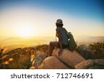 rear view of woman hiker... | Shutterstock . vector #712746691