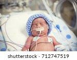 newborn premature baby in the... | Shutterstock . vector #712747519