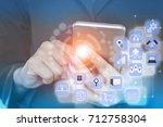 business woman hand holding... | Shutterstock . vector #712758304