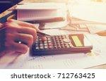 hand man pressing on calculator ... | Shutterstock . vector #712763425