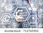 man presses growth hacking gear ... | Shutterstock . vector #712765501