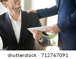 company leader giving money... | Shutterstock . vector #712767091