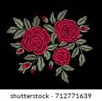 red flower. embroidery. | Shutterstock .eps vector #712771639